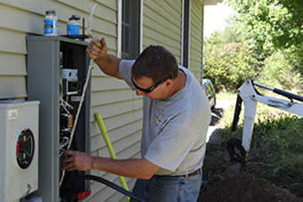 Eric Barbieri doing electrical work